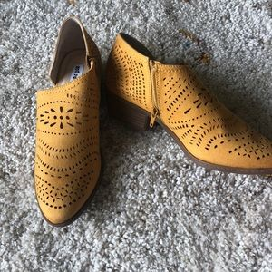 Mustard yellow ankle booties.